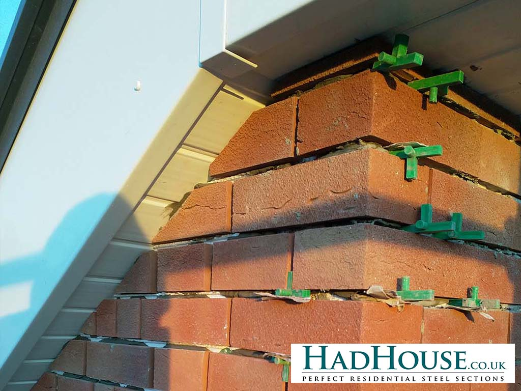 Close-up detailing of the brick slips, fascias and soffets.
