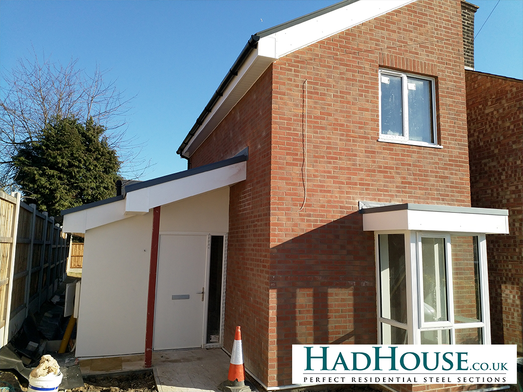 The Finished front of the house showing completed Brick Slips and Render, as well as the fascias, soffets and rain goods.
